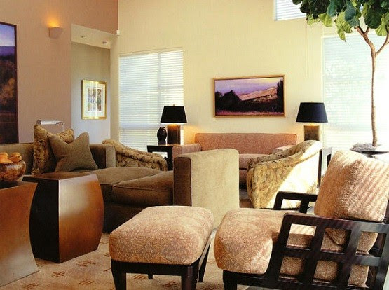 brown theme living room decor with bright cream wall color