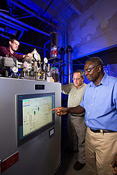 At Wyndmoor, Pennsylvania, chemical engineer Akwasi Boateng (right) and mechanical engineer Neil Goldberg (center) adjust pyrolysis conditions while chemist Charles Mullen loads the reactor with bioenergy feedstock: Click here for photo caption.