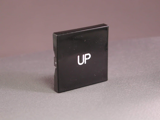 "000176 ""UP"" Plastic Button only"