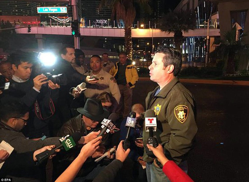 LVMPD Deputy Chief Zimmerman speaks to journalists following an accident close to the location of the Miss Universe beauty pageant final