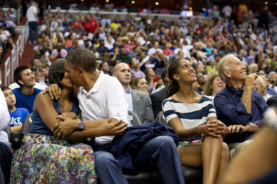 The first couple smooches for the KissCam during a timeout at an Olympic basketball exhibition game in 2012.