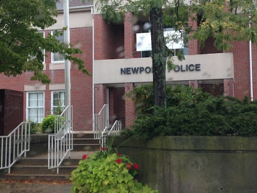 Newport Police Say Drunken Group Played with Rabid Raccoon in Front of City Hall