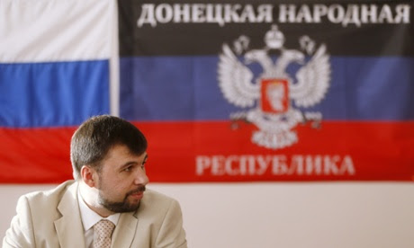 Denis Pushilin in front of a flag of the self-proclaimed Donetsk People's Republic in Donetsk.