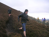 Val Brunton enjoying the heathery descent