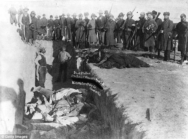 December 1890: Bodies of Sioux Indians are piled into a mass grave hacked into the frozen Dakota soil after the tragedy at Wounded Knee