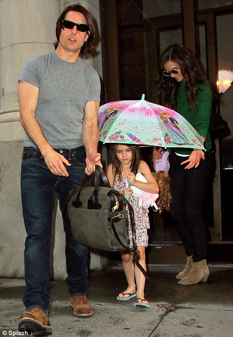 Happy families: Tom Cruise and Katie Holmes have been in New York while she promotes her new film and works on her fashion line