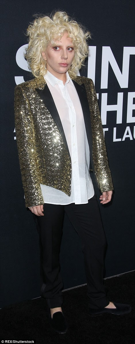 All that glitters: The American Horror Story star wore a sequined Saint Laurent gold tuxedo coat with smart black pants and slip on shoes