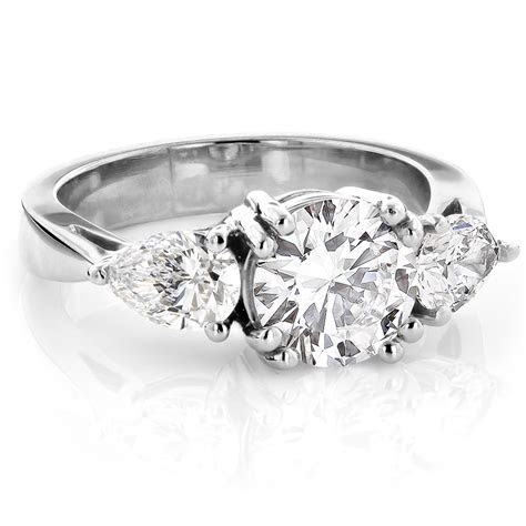 Platinum Three Stone Round and Pear Diamond Engagement
