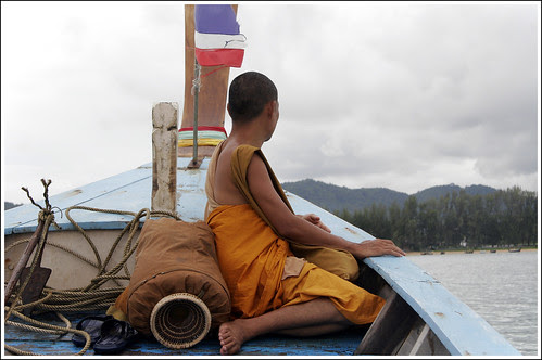 Monk on longtail boat near Rawai Beach, Phuket