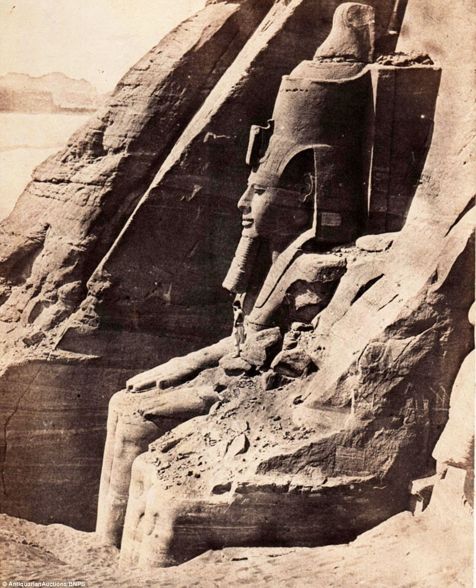 The stunning collection - comprising 59 black and white images of sights including the Abu Simbel statue of Rameses II (pictured) before it was moved - is among the first known volumes of travel photography