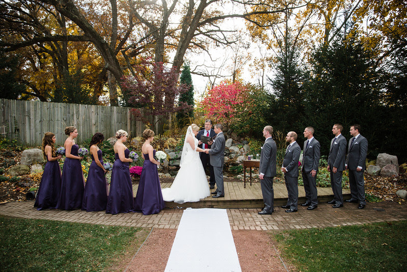 An outdoor autumn wedding ceremony at Williams Tree Farm, north of Rockford IL, for Amy and Dave. The two had a sand unity ceremony in front of there family and friends.