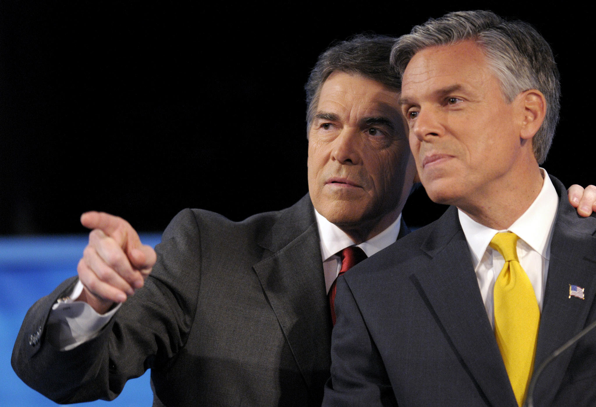 Rick Perry and Jon Huntsman at GOP Debate