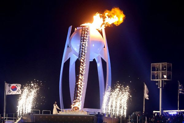 Former figure skater Yuna Kim lights the torch during the opening ceremony of the 2018 Winter Olympic Games in PyeongChang, South Korea...on February 9, 2018.