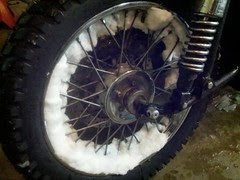Snow stuck in the front wheel of the ural after first winter ride this season.