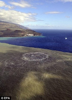 Danger: The dark brown magma off El Hierro, with the town of La Restinga visible on the coast. La Restinga has been evacuated and shipping banned from the area