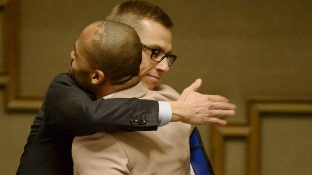 Finland's Prime Minister Alexander Stubb, left, hugs the country's first openly gay MP Jani Toivola after the vote.