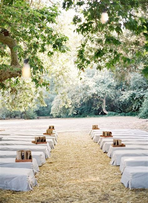 wedding in woods with hay bales as seats   Rustic outdoor
