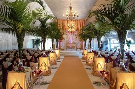 Tall green rainforest themed Indian wedding ceremony. #