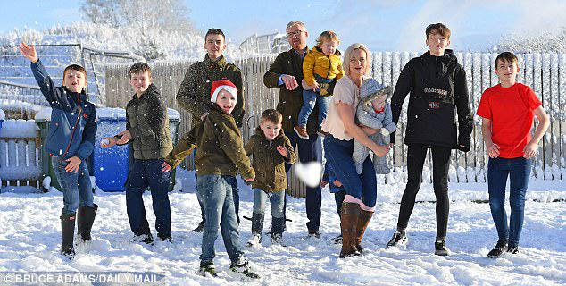 Mrs Brett (pictured with her family)goes to the gym three times a week, has just qualified as a fitness instructor and plans to start giving classes next year. She says she has found it relatively easy 'to ping' back into shape after the birth of each boy because she spends so much time on her feet