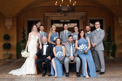 Bridesmaids wearing long steel blue dresses, groomsmen