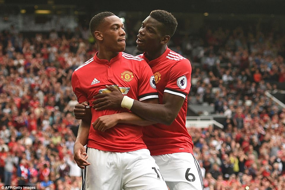 Martial is congratulated by his Manchester United and France national team-mate Pogba after scoring United's third goal