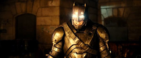 Wearing a metal suit of armor, Batman confronts Superman in BATMAN V SUPERMAN: DAWN OF JUSTICE.
