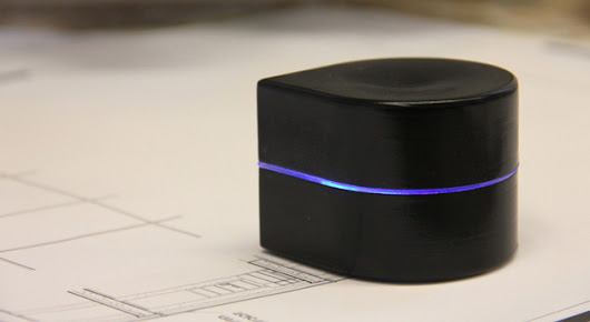 This robot printer runs around the page laying down ink