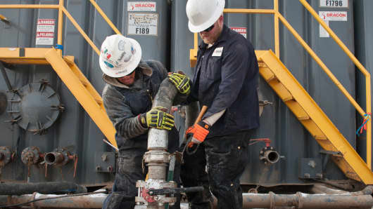 Workers from Select Energy Services at a Hess fracking site near Williston, N.D.
