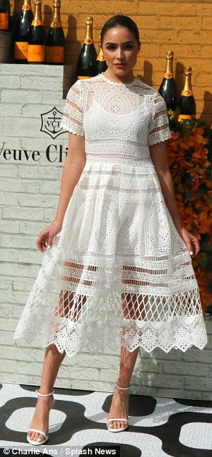 Hello doily! Olivia Culpo was picture perfect in a lace dress worn over a white slip for modesty