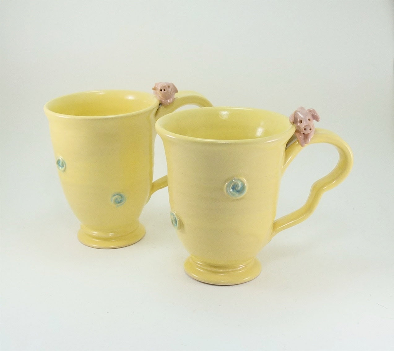 awesome pair of yellow piggy mugs