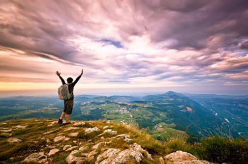 [Graphic of a man rejoicing on a mountain top]