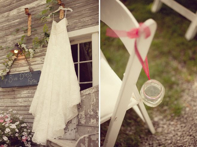 Bride 39s ivory lace wedding dress hangs outside ceremony chairs decorated