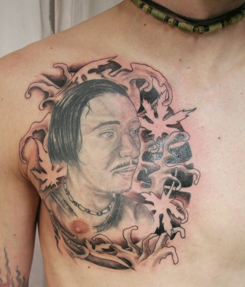 Asian Face Tattoo On Man Chest