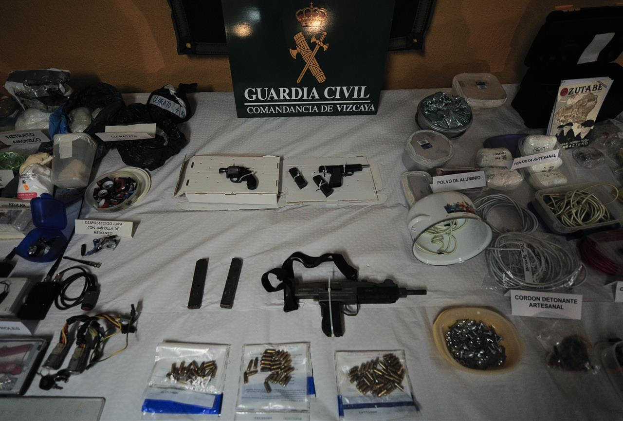 In this March 1, 2011 file photo, a display of munitions, weapons and 200 kilograms of explosives captured from the Basque separatist group ETA by the Civil Guard are displayed in Bilbao, northern Spain. Spanish media are reporting that ETA are set to announce Friday March 17, 2017 its new initiative to lay down weapons aimed at speeding the stalled process of disbanding.