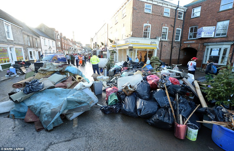 Clearing the road: The clean up began in Tadcaster earlier with residents, members of the local community and volunteers helping out