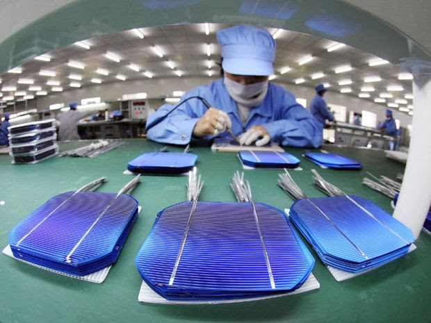 factory worker in China inspects