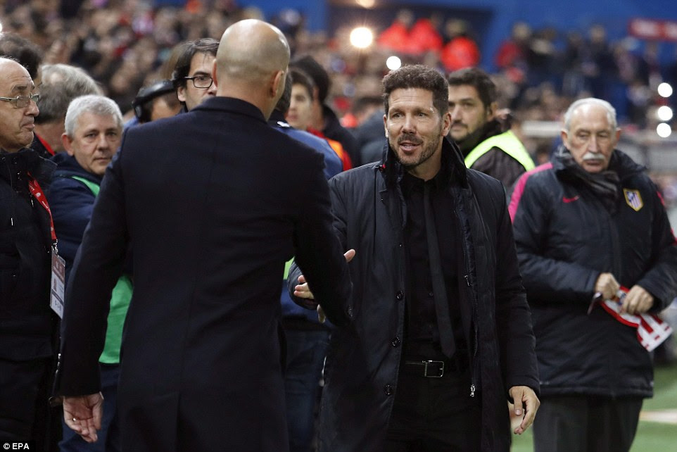 Opposition managers Diego Simeone and Zinedine Zidane shake hands on the touch line before kick-off in the La Liga clash