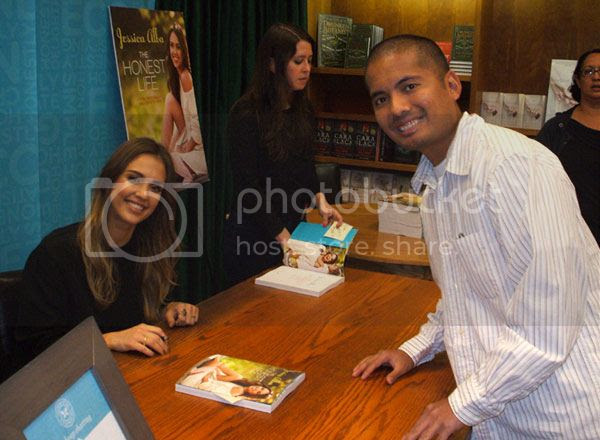 Posing with Jessica Alba at an autograph signing in Pasadena on March 16, 2013.
