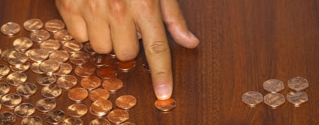 Thomas Daigle paid off his mortgage with 62,000 pennies (Thinkstock/Getty Images)
