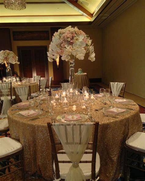 An elegant wedding reception in champagne, gold, blush