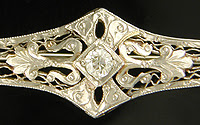 Edwardian brooch set with a sparking Old European Cut diamond. (J3853)