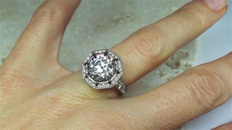 Scalloped halo ring by David Klass Jewelry.   Halo Rings