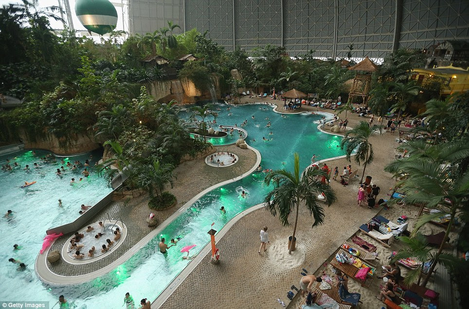 Relaxing: Tropical Islands is inside a hangar built originally to house airships designed to haul long-distance cargo. Visitors can be seen swimming in the lagoon at the resort