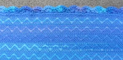 Close-up of crochet shell edging.