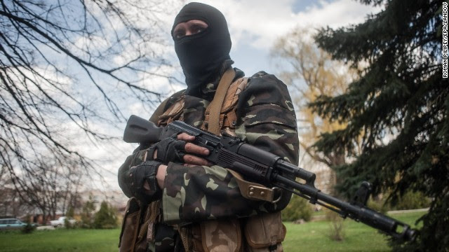 A masked gunman stands guard near tanks in Slaviansk, Ukraine, on Wednesday, April 16. Ukraine has seen a sharp rise in tensions since a new pro-European government took charge of the country in February. Moscow branded the new government illegitimate and annexed Ukraine's Crimea region last month, citing threats to Crimea's Russian-speaking majority. And in eastern Ukraine, pro-Russian separatists have seized government and police buildings in as many as 10 towns and cities.