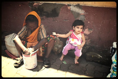 A Childs Tryst With Charity by firoze shakir photographerno1