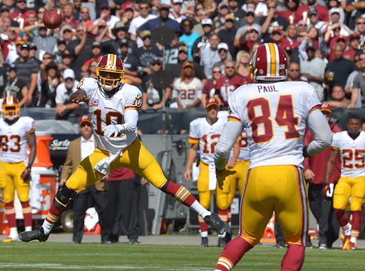 Redskins coaches seeing growth, maturation in Robert Griffin III's game