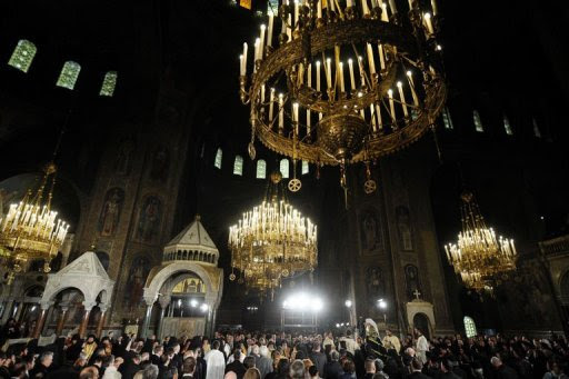 The Bulgarian Orthodox Church's newly elected Patriarch Neophyte (C), participates in his enthronement ceremony at the golden-domed