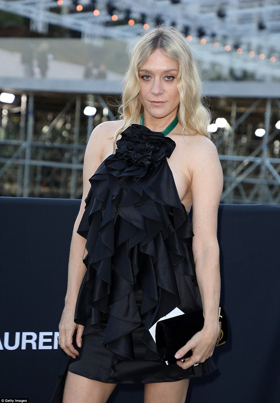 Blonde beauty:Fashionista Chloë Sevigny opted for a funky look complete with knee-high boots and a halterneck dress - in what was one of the sexiest looks of the show