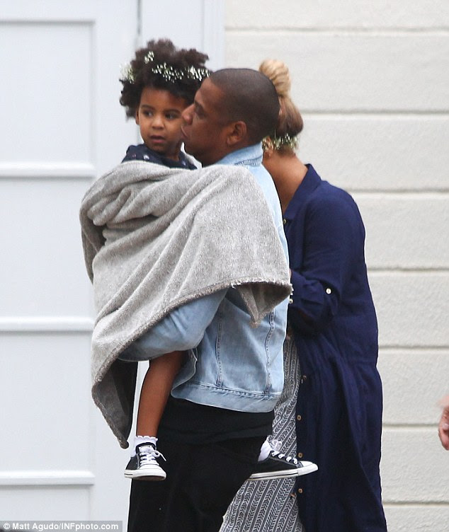 Daddy's girl: For Jay there was no floral adornment, with the 46-year-old record producer and hip hop star dressed in white pumps, black jeans and a denim jacket